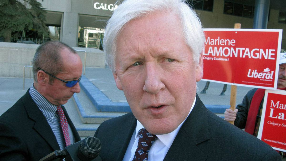Liberal foreign affairs critic Bob Rae talks to reporters while campaigning in Calgary on April 11, 2011.