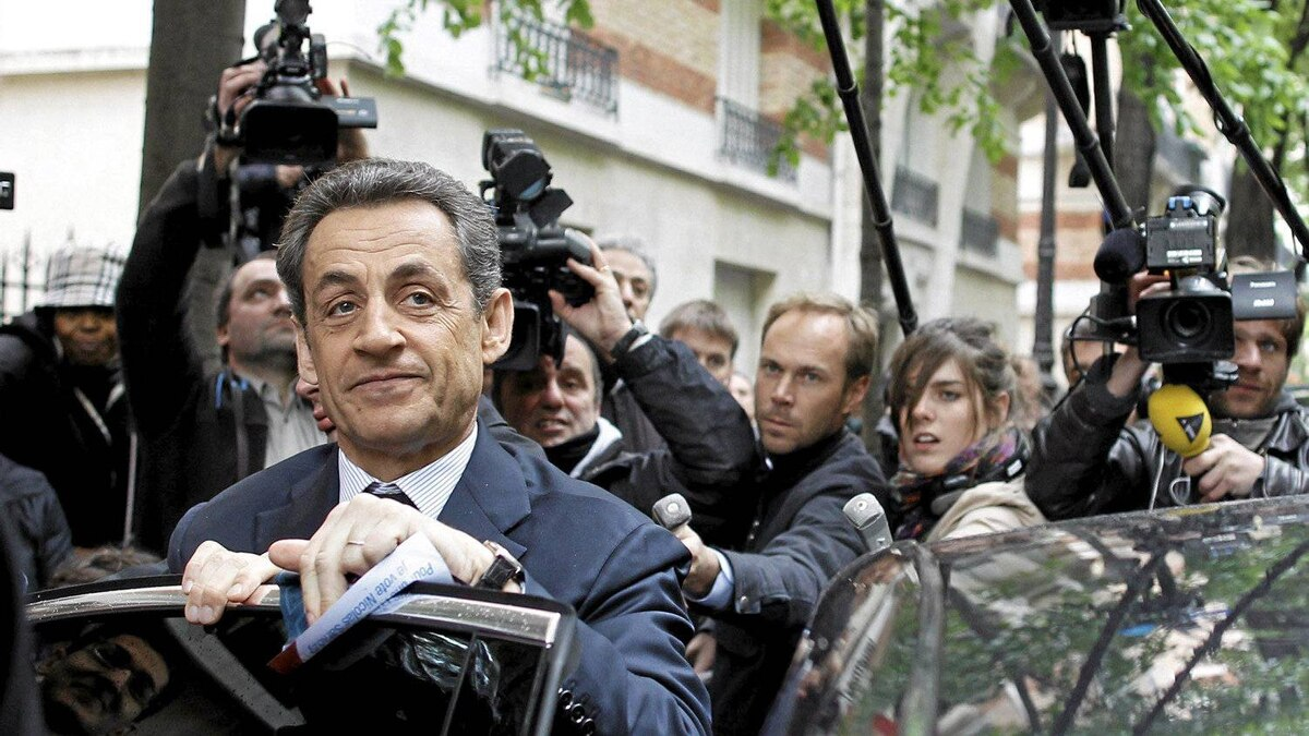 French President and UMP party candidate for France's presidency Nicolas Sarkozy prepares to enter a car as he leaves his campaign headquarters the morning after the first round of voting in Paris, Monday, April 23, 2012. French Socialist Francois Hollande came first in Sunday's initial round of voting.