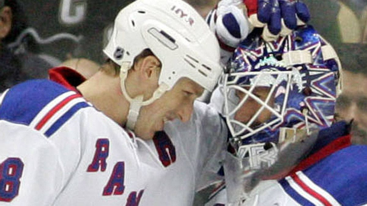 New York Rangers defender Marc Staal (18) congratulates goalie Henrik Lundqvist (30) after defeating the Pittsburgh Penguins during the third period at the CONSOL Energy Center. The Rangers won 3-1. Charles LeClaire-USPRESSWIRE