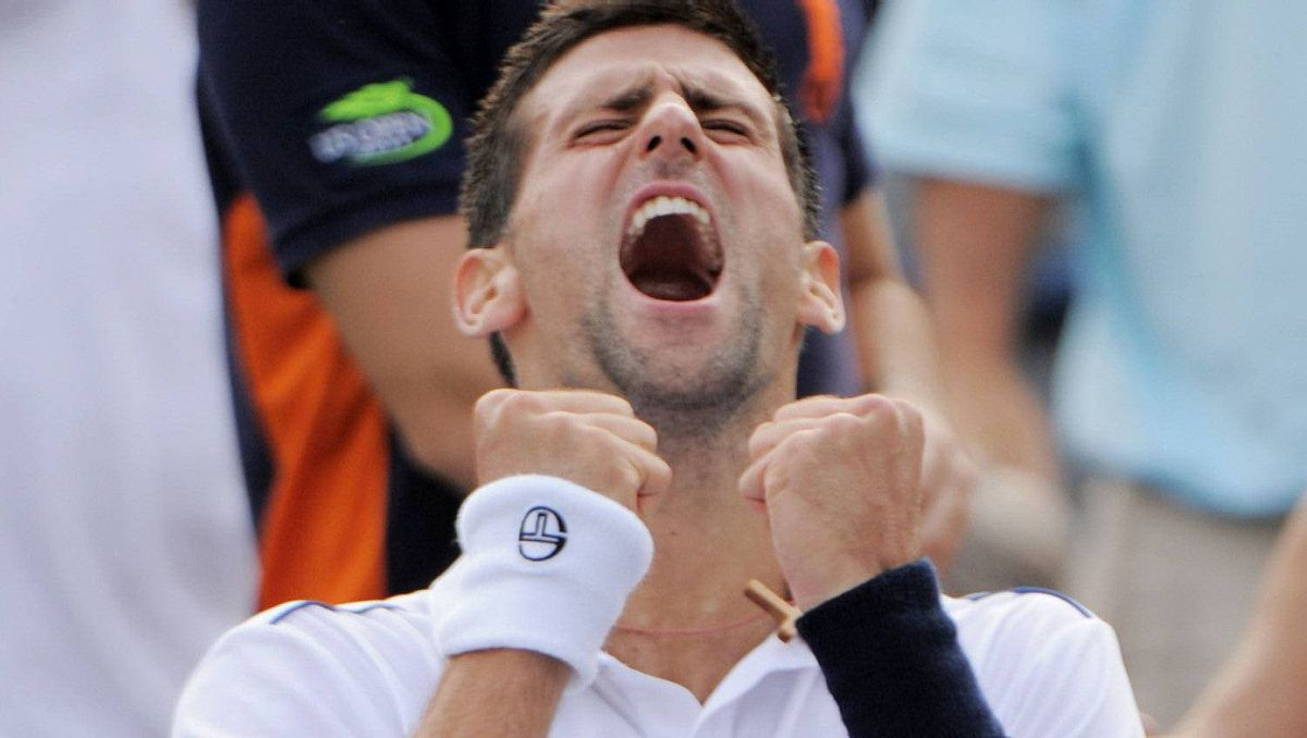 Number one seed Novak Djokovic of Serbia reacts after winning the first set tiebreak 16-14 against Alexandr Dolgopolov of Ukraine during a Men's fourth round match at the US Open tennis tournament on September 5, 2011 at the Billie Jean King National Tennis Center in New York. Getty Images/Stan HONDA