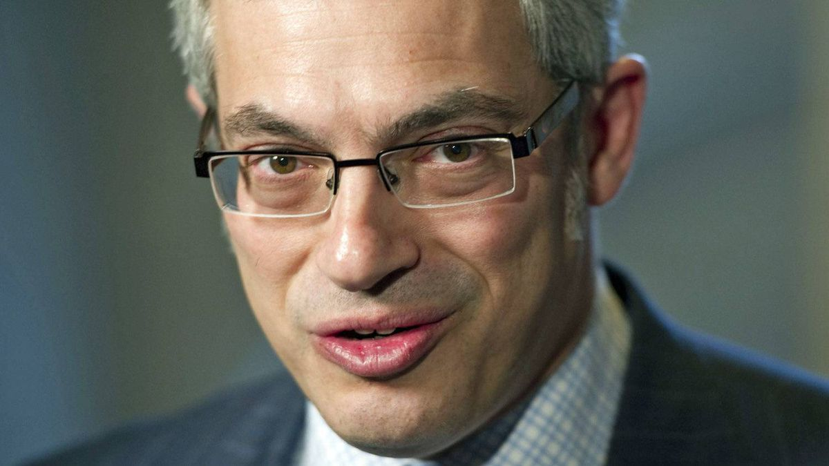 Tony Clement speaks with reporters in the foyer of the House of Commons on Feb. 1, 2011.