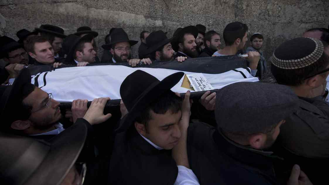 Family members and friends carry the body of Rabbi Jonathan Sandler during the March 21 funeral in Jerusalem of victims of Monday's shooting in Toulouse, France.