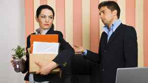 A businesswoman is fired from her job.