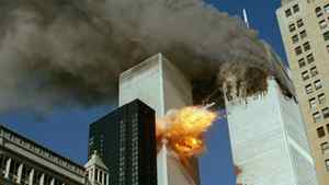 In this Sept. 11, 2001 file photo, United Airlines Flight 175 collides into the south tower of the World Trade Center in New York as smoke billows from the north tower.