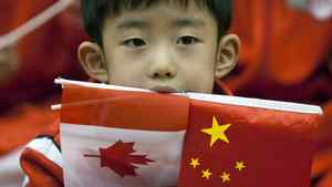 A student keeps his eyes wide during a visit by Prime Minister Stephen Harper to the Canadian International School in Beijing on Dec. 4, 2009.