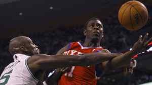 Philadelphia 76ers' Jrue Holiday (R) drives to the net past Boston Celtics' Kevin Garnett during the seond quarter. REUTERS/Brian Snyder