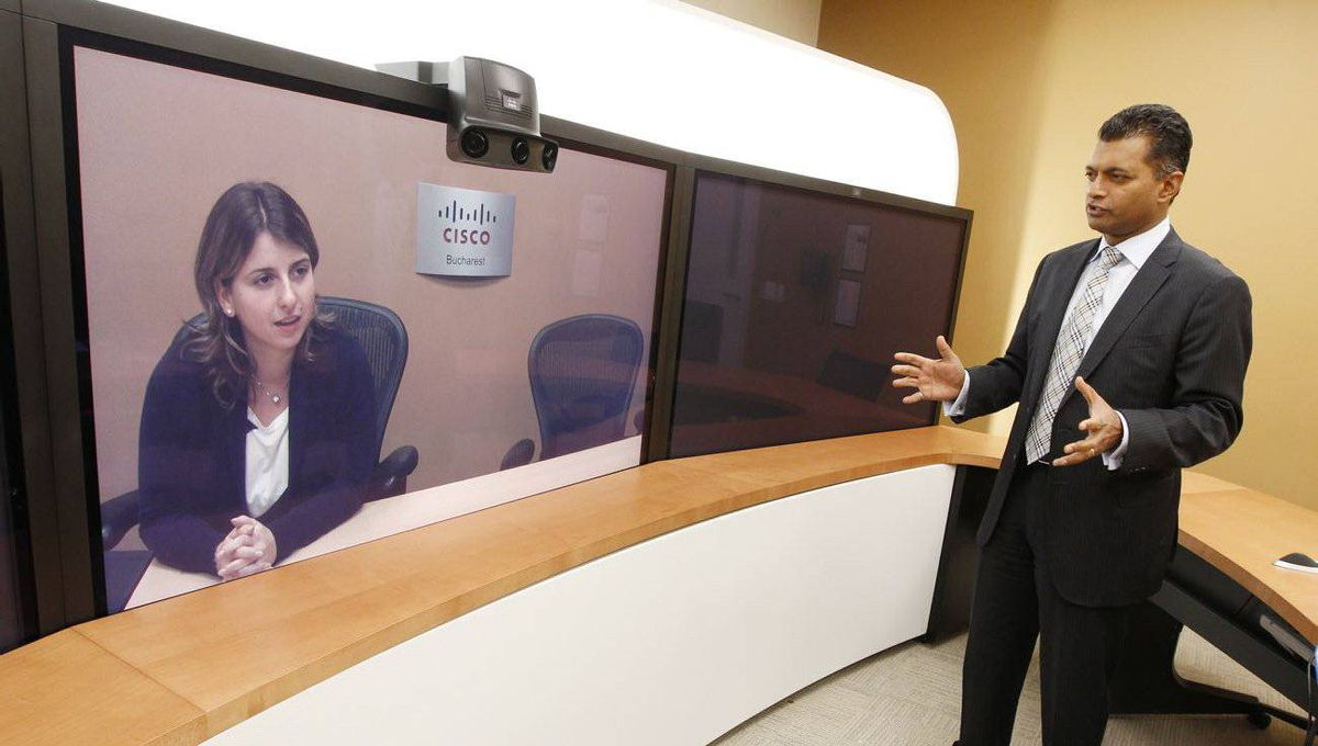 Nitin Kawale, president of Cisco Systems Canada in Toronto, uses video conferencing to speak with his mentor, Ioana Birleanu, a Cisco business manager based in the Netherlands.