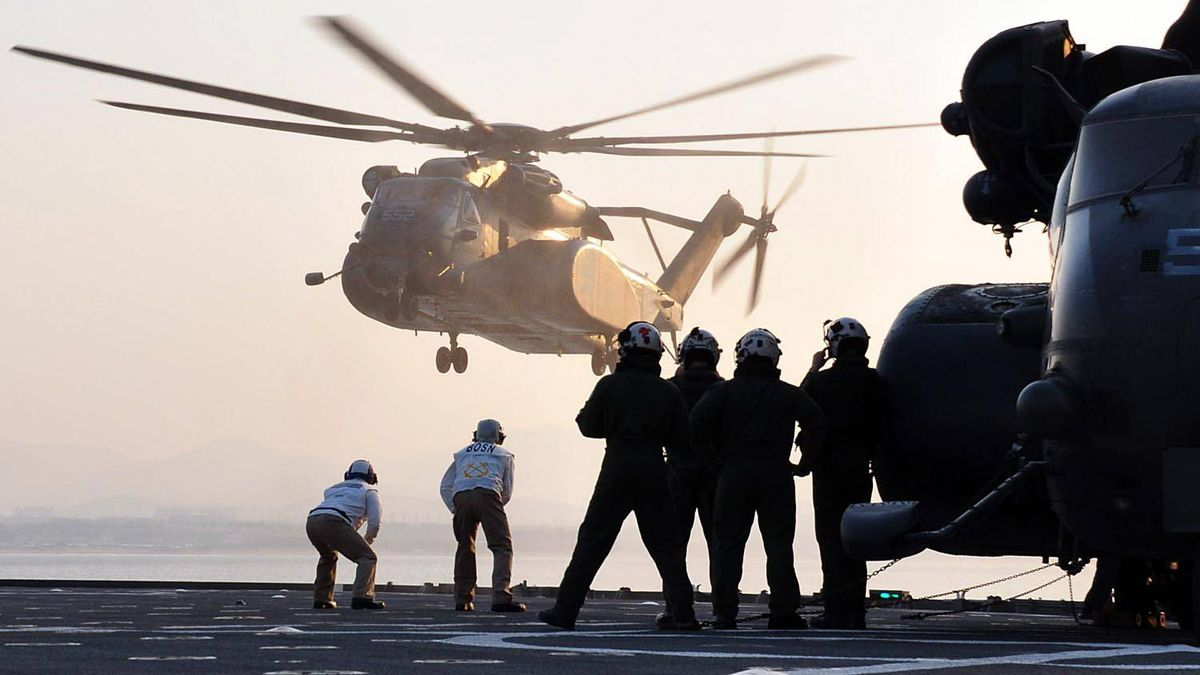 In this image released by the US Navy, MH-53 helicopters land, March 12, 2011 aboard the amphibious dock landing ship USS Tortuga (LSD 46) in the Sea of Japan.