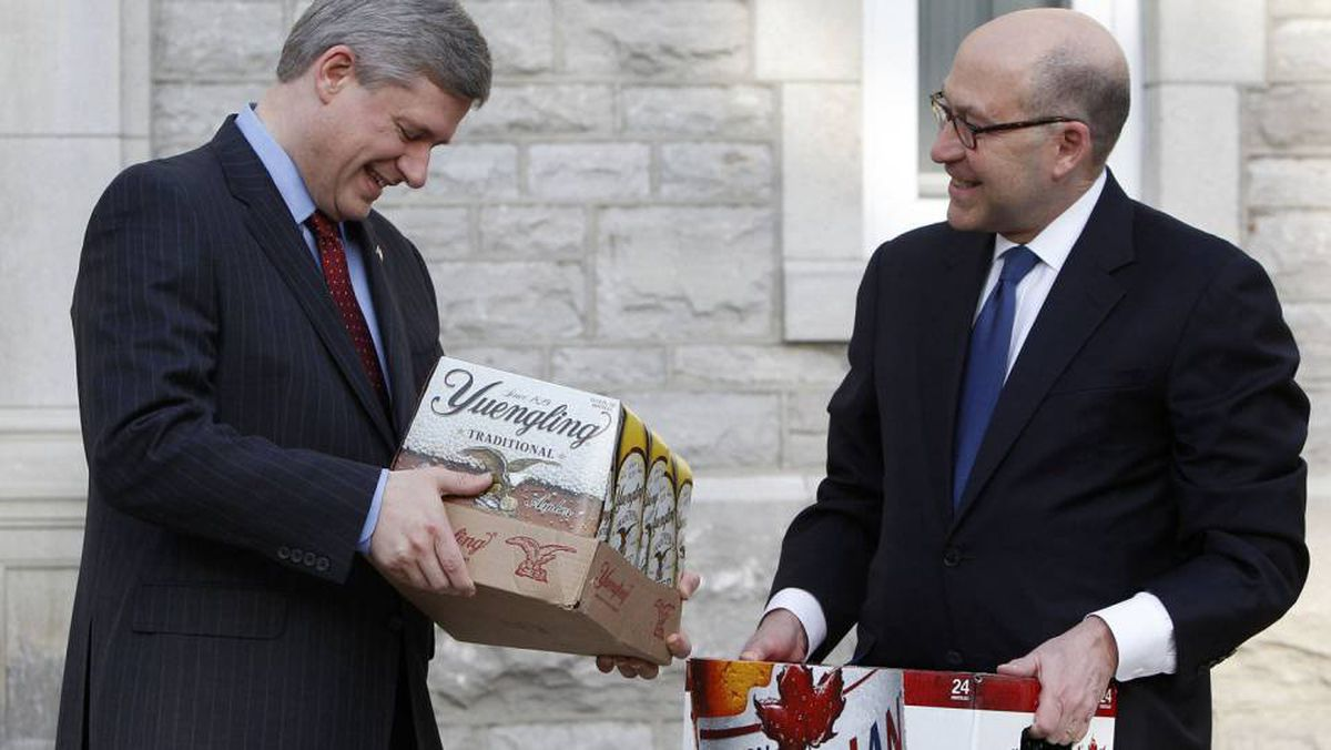 Prime Minister Stephen harper receives two cases of beer from U.S. Ambassador David Jacobson in mid-March after winning a bet with President Barack Obama when Canada's men's hockey team won the Olympic gold medal