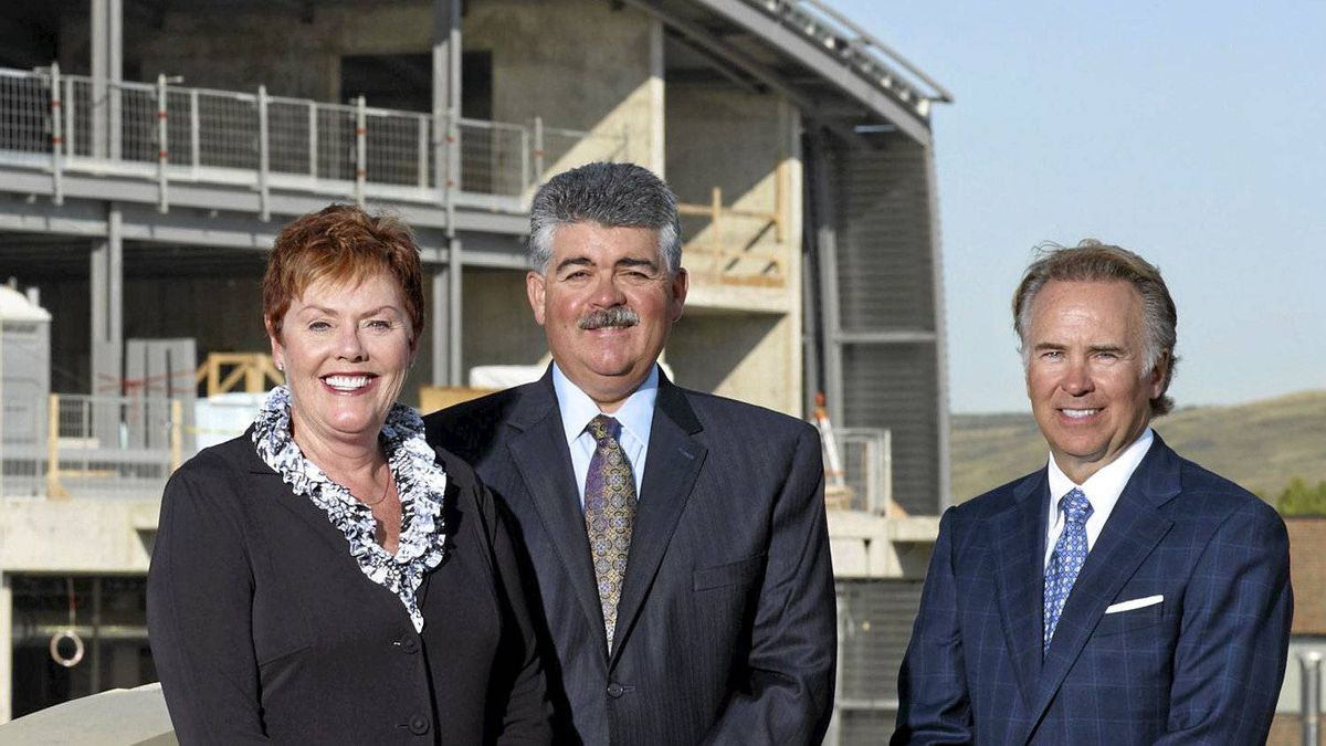 Doug Ramsay (centre) with wife Susan and business partner Ron Mathison, on the site of the future Ramsay Centre for Petroleum Engineering at SAIT Polytechnic in Calgary.