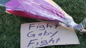 A sign referring to wounded congresswoman Gabrielle Giffords is seen at a makeshift memorial outside the hospital where she is recovering in Tucson, Arizona January 9, 2011.