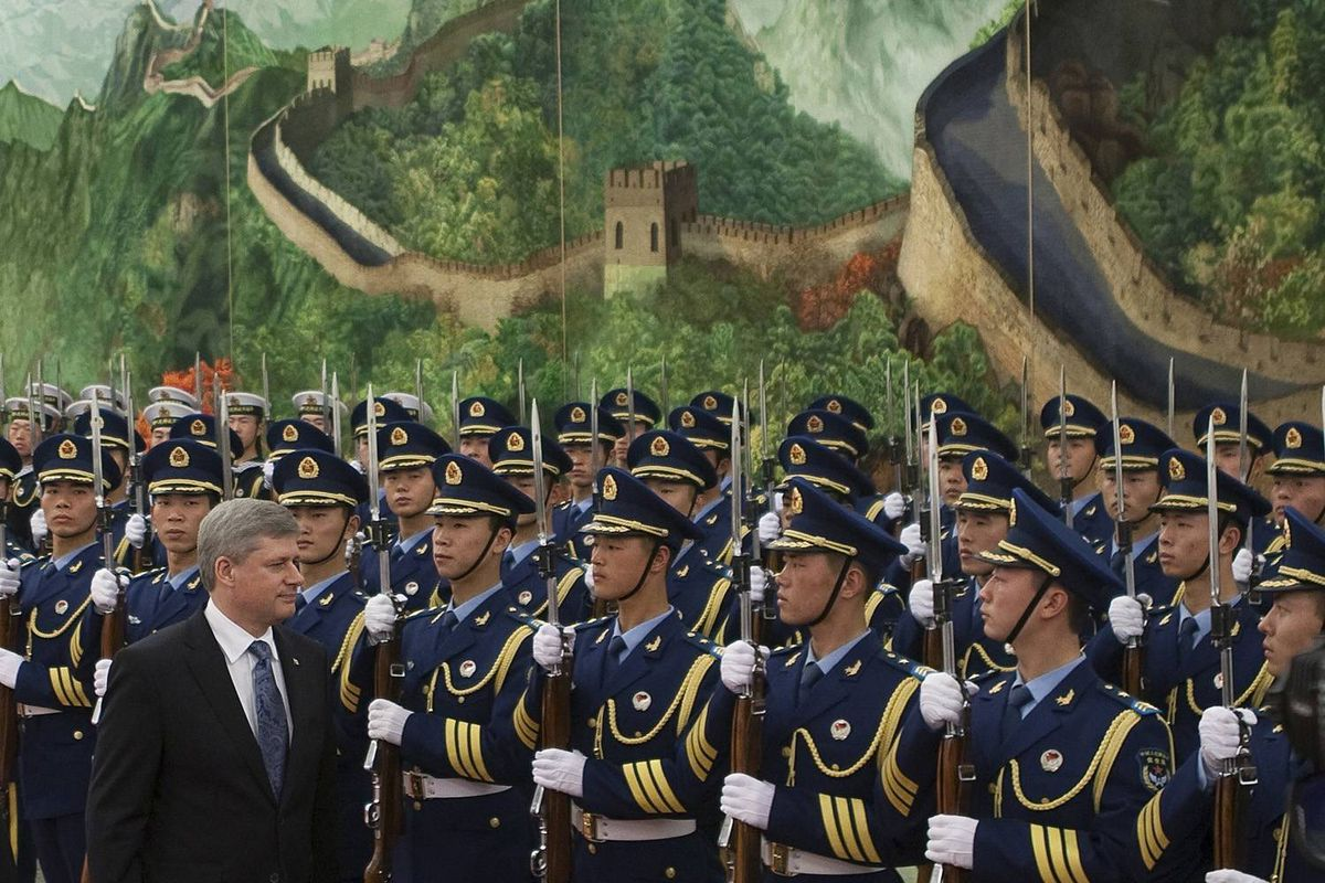 Prime Minister Stephen Harper inspects the honour guard with Wen Jiabao, Premier of the Peolpe's Republic of China, in the Great Hall of the People in Beijing, China on Thursday, December 3, 2009.