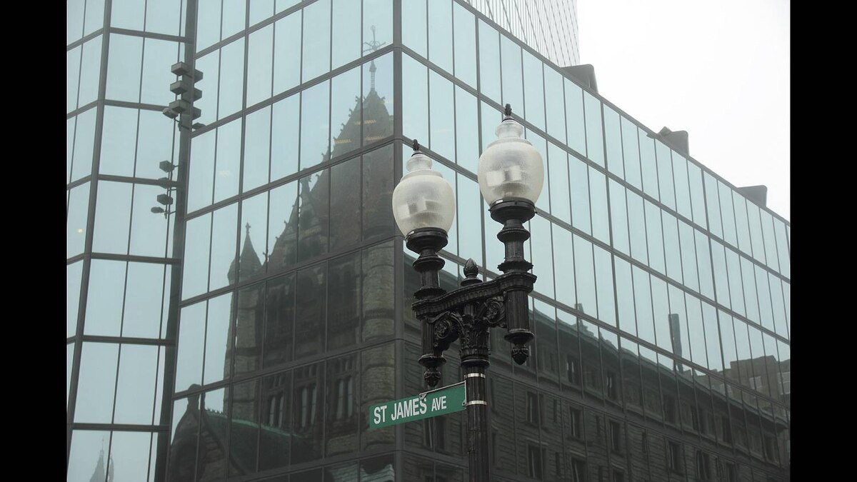 Anthony Broski photo: Reflection of Beauty - The gothic cathedral is reflected in the windows of a modern glass skyscraper on a very foggy day in Boston last October.