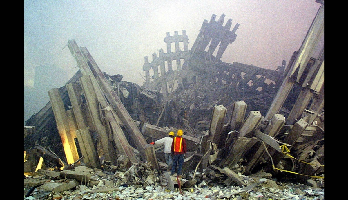 Rescue workers survey damage to the World Trade Center on Sept. 11, 2001 in New York.