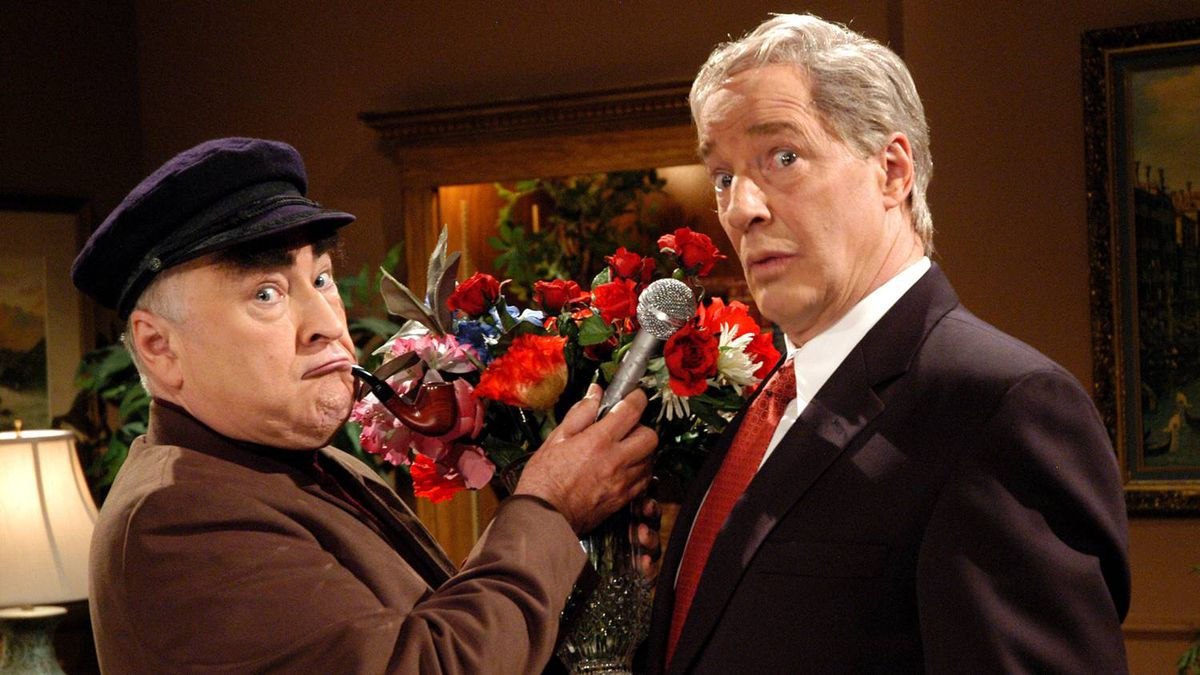 Roger Abbott, left, as author Peter C. Newman interviewing Don Ferguson as Prime Minister Paul Martin in the Air Farce's New Year's Eve special, which aired Dec. 30, 2005.
