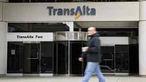 A pedestrian walks past the TransAlta building in downtown Calgary, Monday, Oct. 5, 2009.