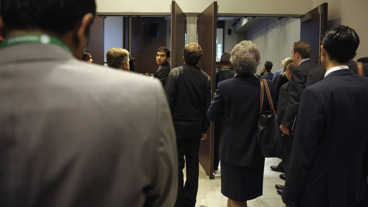 Crowds stream out of meeting rooms after talks at the Small Business Summit held at the MaRS Discovery District in Toronto on Nov. 8, 2011.