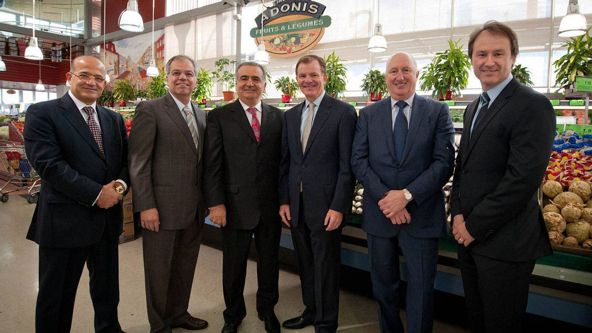 Left to right, Marché Adonis founders Elie Cheaib, Georges Ghrayed and Jamil Cheaib are pictured with Metro CEO Eric La Fleche, COO Robert Sawyer and CFO Richard Dufresne after announcing that Metro has bought a majority stake in the Montreal grocery chain.