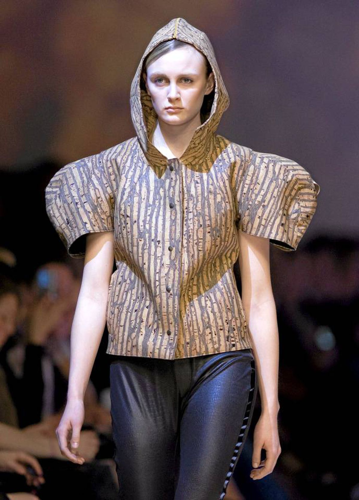 Evan Biddell played with exaggerated volume by sculpting clothes away from the body. Unusual fabrics, like the cork shown here, were manipulated into shapes that ranged from highly wearable to downright outrageous.