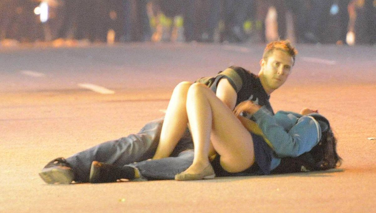 A couple lies on a street in Vancouver, Canada during riots after their hockey team the Vancouver Canucks lost in Game Seven of the Stanley Cup Finals.