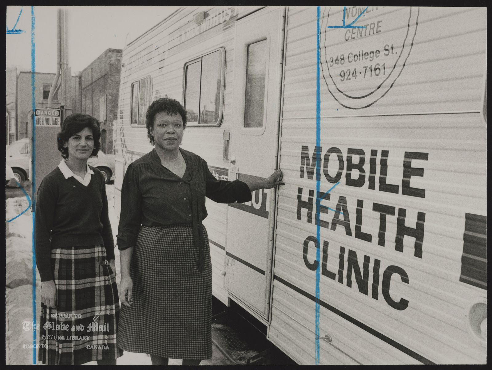 TORONTO city Health Department Miriam Zeballos (left), Patricia Hayes with Toronto mobile health clinic.