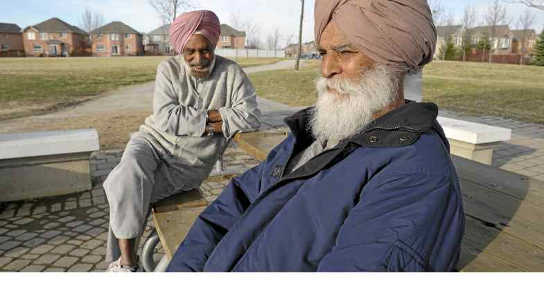 Kanga Sadhu and Joginder Pooni chat about politics in a gazebo in Brampton, Ont., April 12, 2011.
