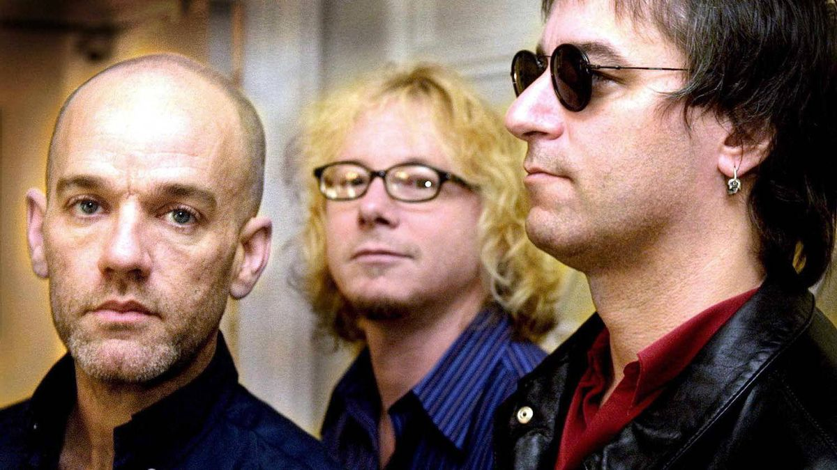 R.E.M. members (from left) Michael Stipe, Mike Mills and Peter Buck in London in 2001.