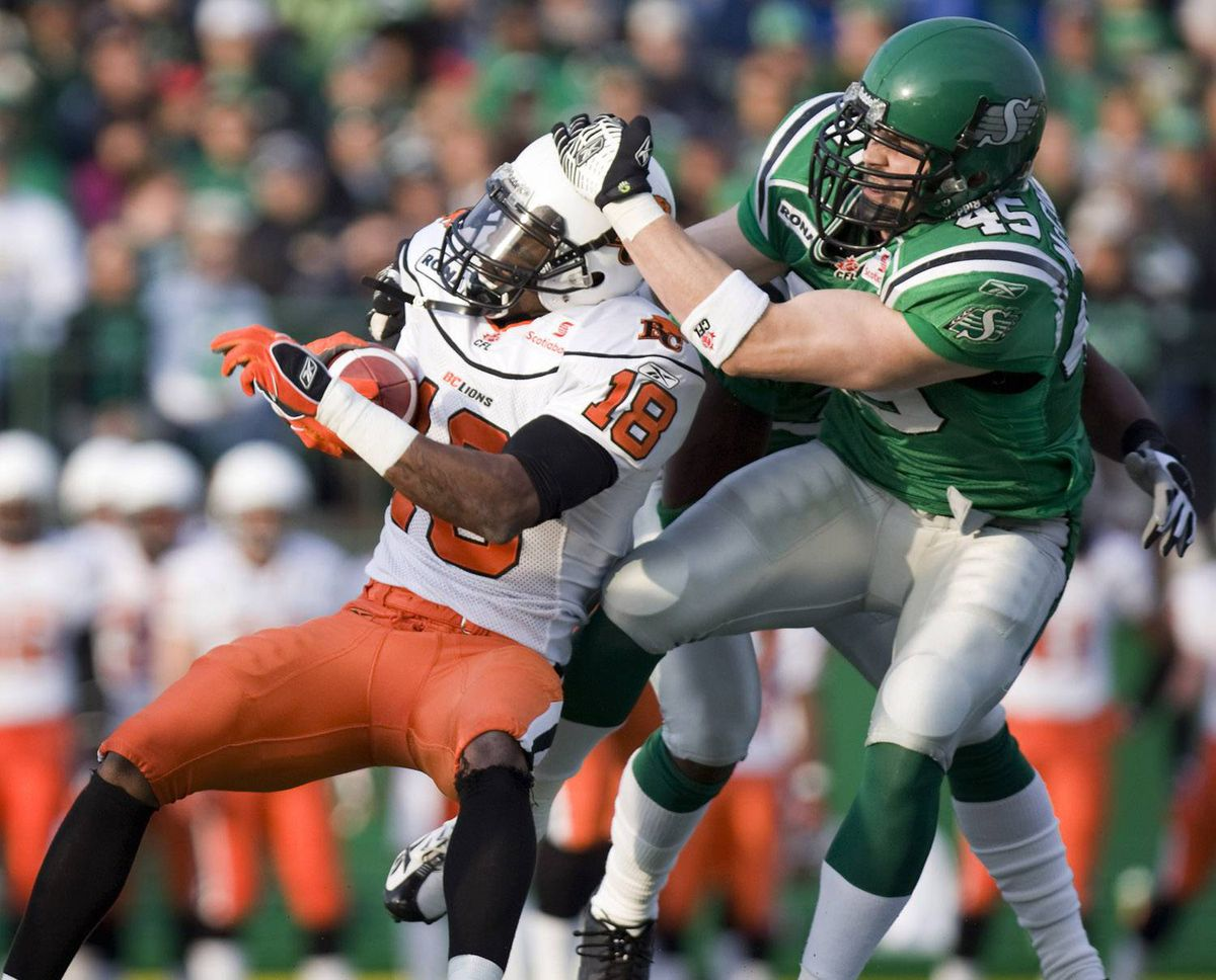 B.C. Lions slot back Cory Rodgers (left) is brought down by Saskatchewan Roughriders' Mike McCullough in first quarter CFL action on Friday, June 13, 2008 in Regina. THE CANADIAN PRESS/Troy Fleece