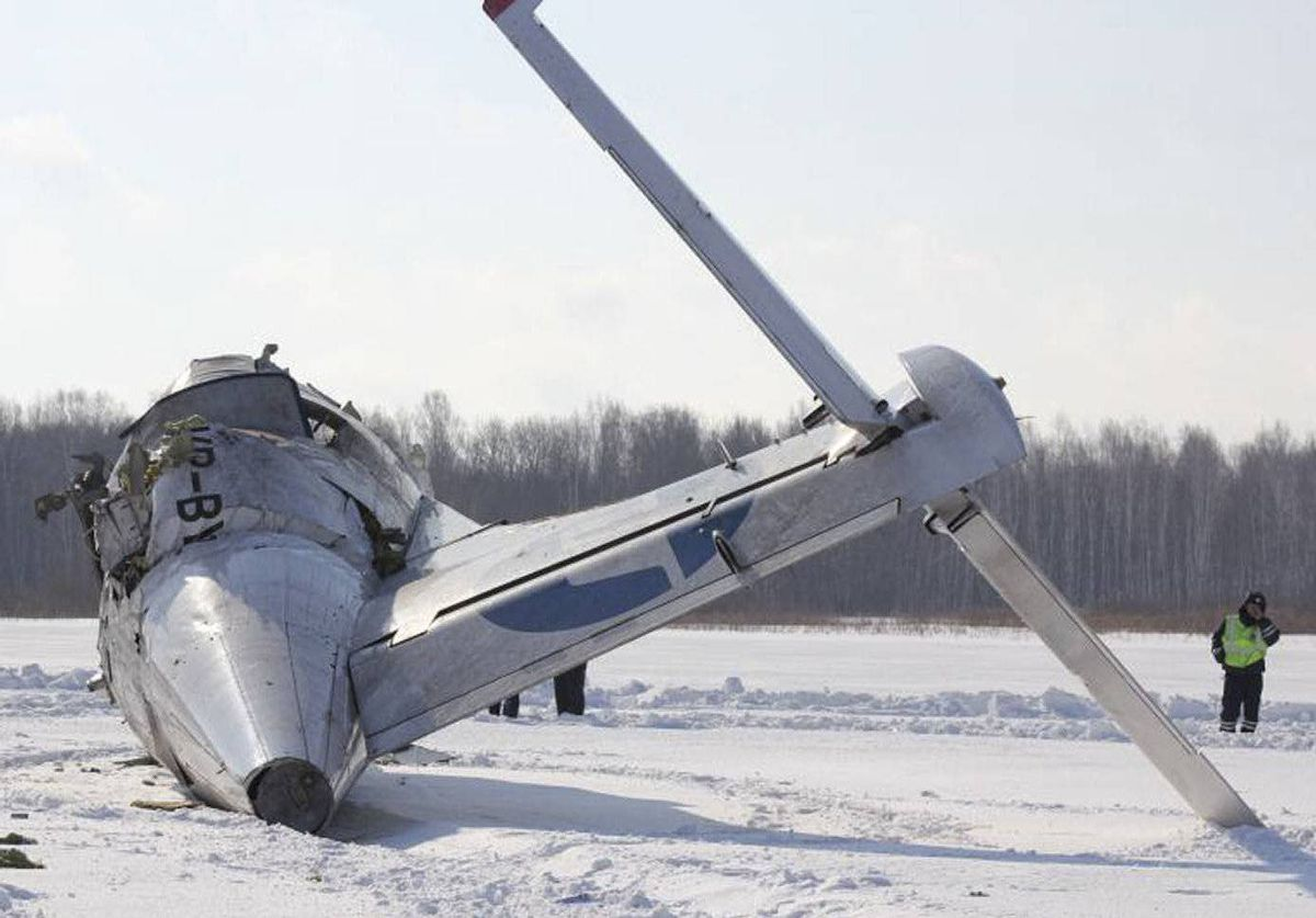 An emergency service worker stands near the tail section of the UTair airlines ATR 72 passenger plane that crashed after takeoff near the Siberian city of Tyumen. At least 31 of the 43 people on board were killed.