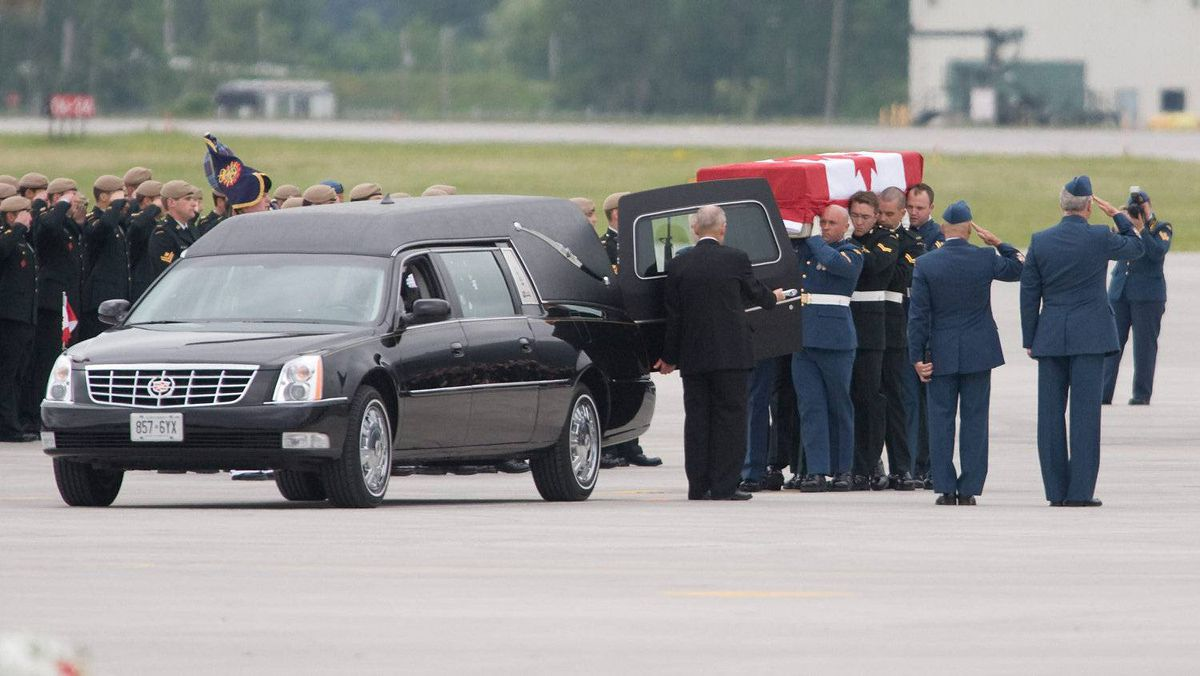 The casket of Master Cpl. Francis Roy is carried to a waiting hearse during a repatriation ceremony at CFB Trenton, Ont. on Wednesday, June 29, 2011. MCpl. Roy died Saturday of causes not related to combat at a forward operating base in Kandahar.