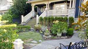 A large garden in the front and a patio in the back are ideal for outdoor entertaining on warm Vancouver nights.