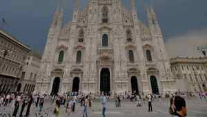 People walk on Duomo Square in Milan
