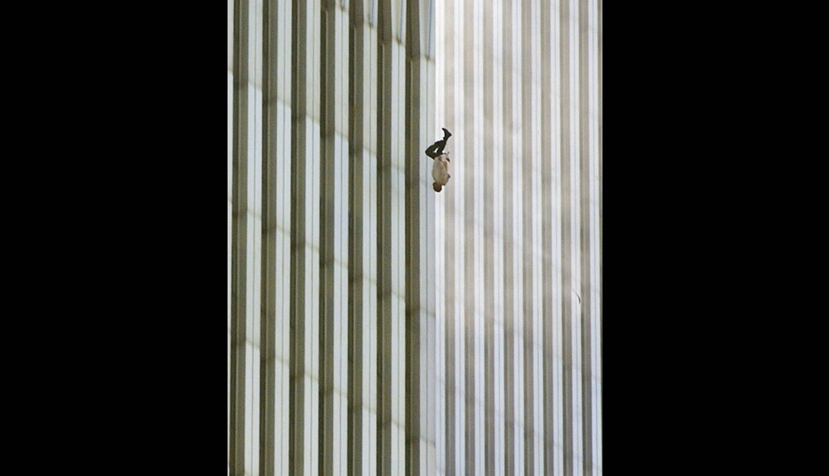 """In this Tuesday, Sept. 11, 2001 file picture, a person falls headfirst from the north tower of New York's World Trade Center. This photo later became known as """"The Falling Man""""."""