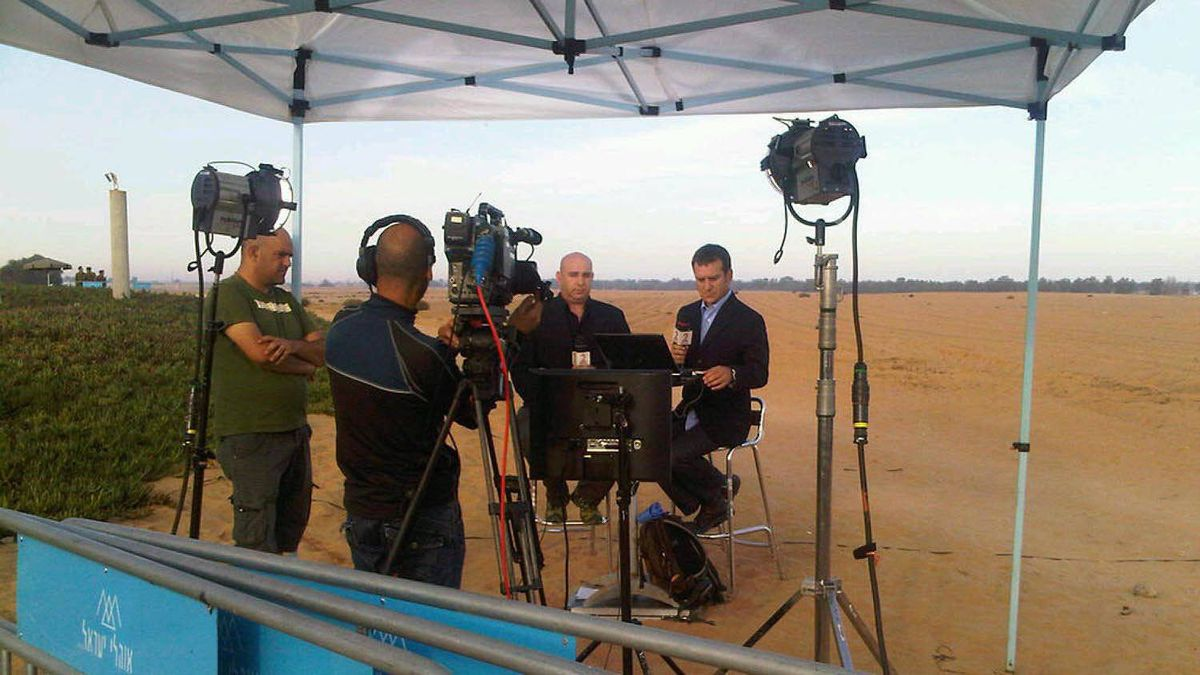 Israeli Television prepares to broadcast from Kerem Shalom crossing at the junction of Israel, Gaza and Egypt. Israeli soldier Gilad Shalit will be crossing from Gaza to Egypt, then into Israel at about 9 am local time. The Kerem Shalom kibbutz near which Sgt. Shalit was abducted more than five years ago is in the background, to the right.