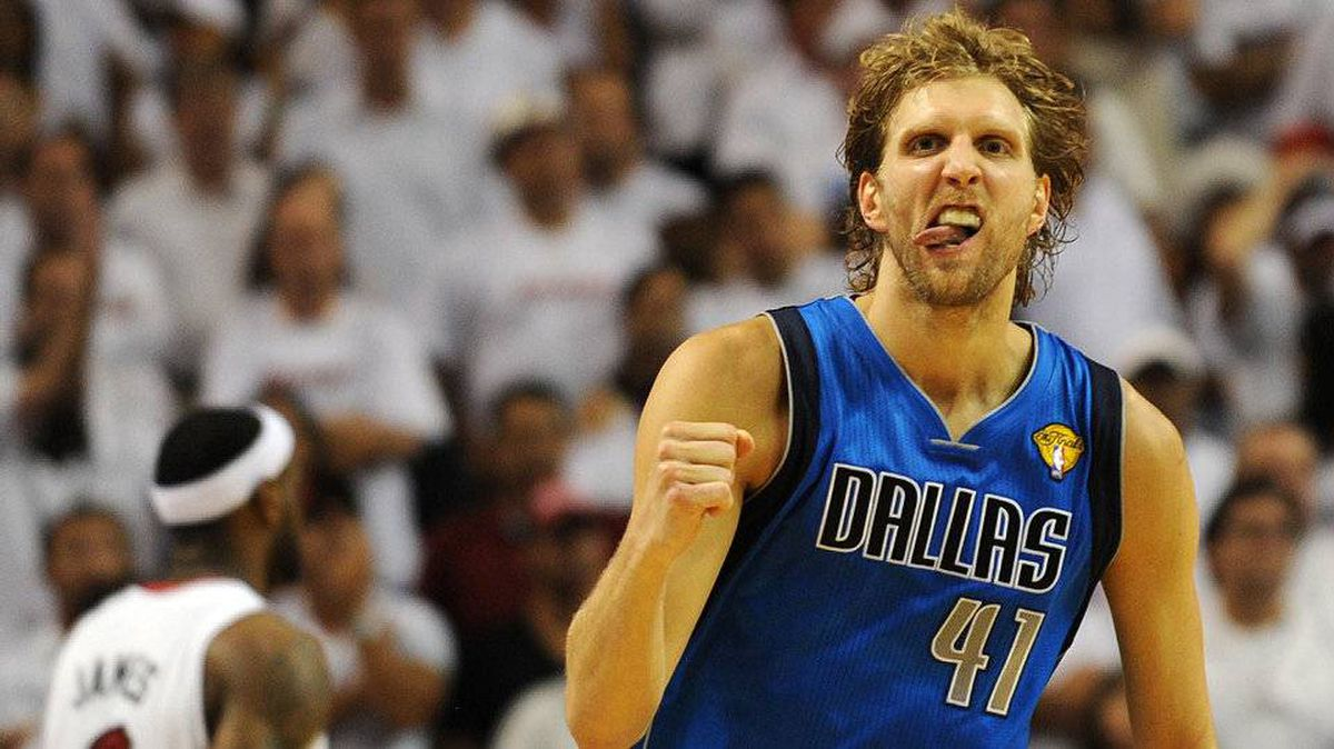 Dirk Nowitzki of the Dallas Mavericks celebrates a point against the Miami Heat in Game 6 of the NBA Finals on June 12, 2011 at the AmericanAirlines Arena in Miami.