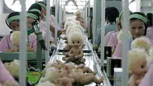 File photo of labourers working at the production line of a toy factory in Panyu, south China's Guangdong province.