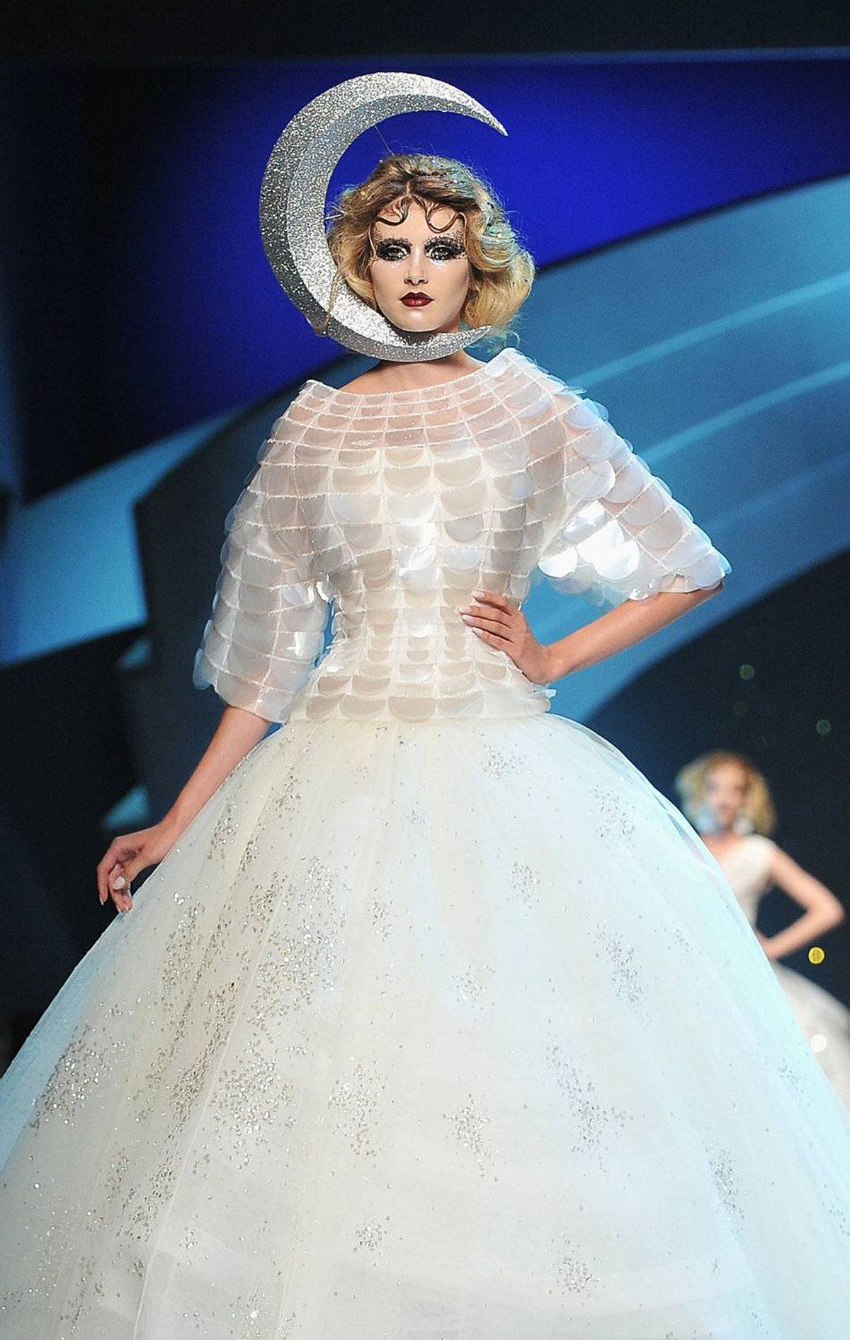 This was also a year of silly headpieces - on and off the runway. Like this. Well, at least she doesn't have her head in the clouds.