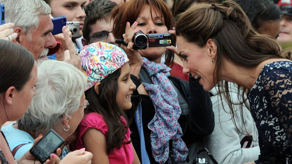 The Duchess of Cambridge shakes hands as she greets the crowds as she and Prince William take part in a ceremony at the National War Memorial in Ottawa on Thursday, June 30, 2011