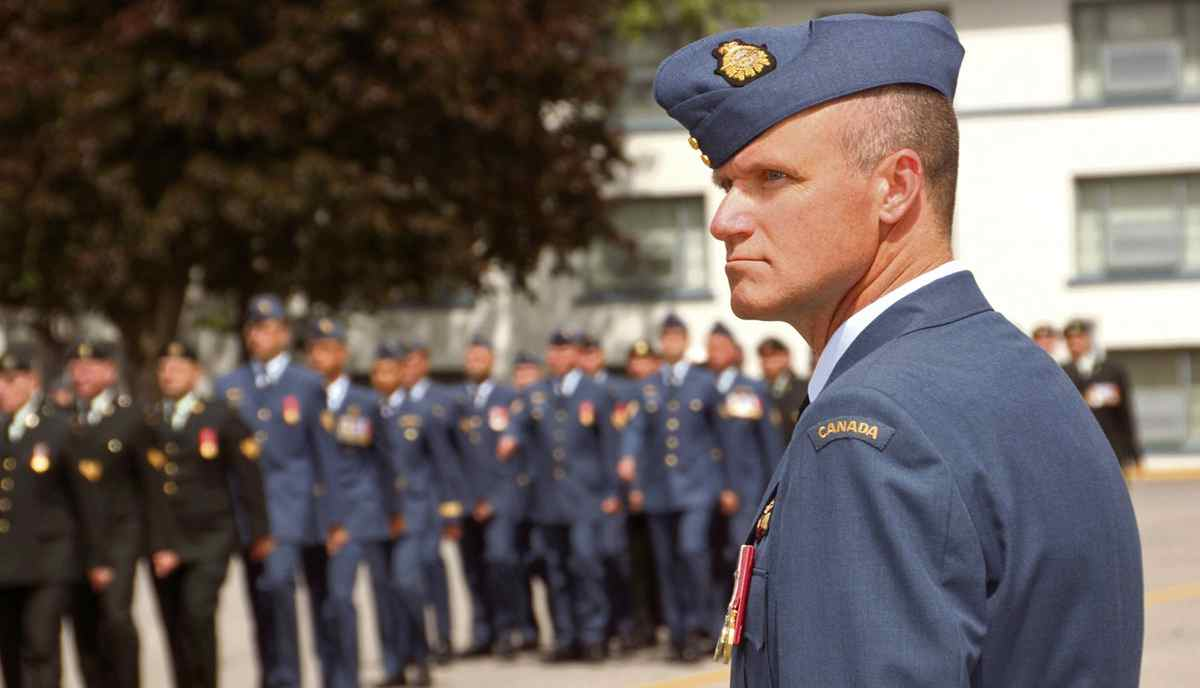 Former Colonel Russell Williams is pictured during transfer of command of 8 Wing/CFB Trenton July 15, 2009. The one-time commander of the Trenton air base was sent to Kingston Penitentiary after four days of shocking testimony in a Belleville, Ont., court where he pleaded guilty to a series of burglaries, sex assaults and the brutal sex slayings of Marie-France Comeau , 37, who served under his command, and Jessica Lloyd, 27.