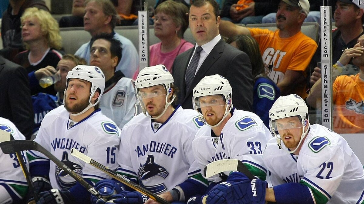 Head Coach Alain Vigneault of the Vancouver Canucks looks on from the bench area. (Photo by Victor Decolongon/Getty Images)