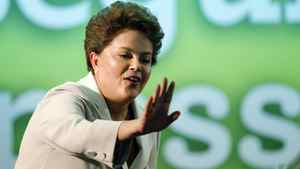 Brazil's Dilma Rousseff waves to supporters during her victory speech in Brasilia.