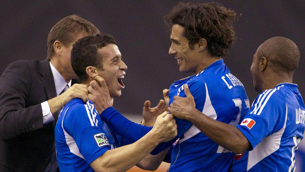 Montreal Impact's Bernardo Corradi (2nd R) celebrates his goal with team mates Felipe Martins (2nd L), Collen Warner (R) and coach Jesse Marsch (L) during the second half of their MLS soccer match against Portland Timbers in Montreal, Quebec, April 28, 2012. REUTERS/Christinne Muschi