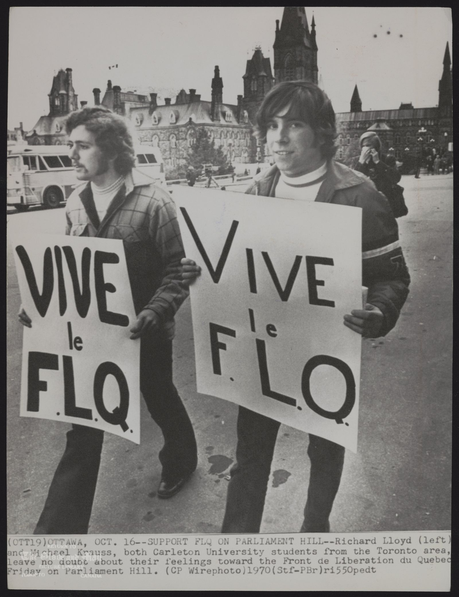 DEMONSTRATIONS Political (OTT19) OTTAWA, OCT. 16--SUPPORT FLQ ON PARLIAMENT HILL --Richard Lloyd (left) and Michael Krauss, both Carleton University students from the Toronto area, leave no doubt their feelings toward the Front de Liberation du Quebec Friday on Parliament Hill. (CP Wirephoto) 1970 (Stf-PBr) ri550pedt