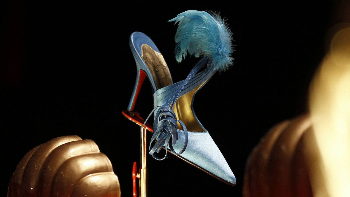 The retrospective exhibition at London's Design Museum traces Louboutin's rise from a teenager fascinated by the feathered costumes of Paris's cabaret showgirls to his stints at YSL and Chanel to setting up his first boutique in 1991.