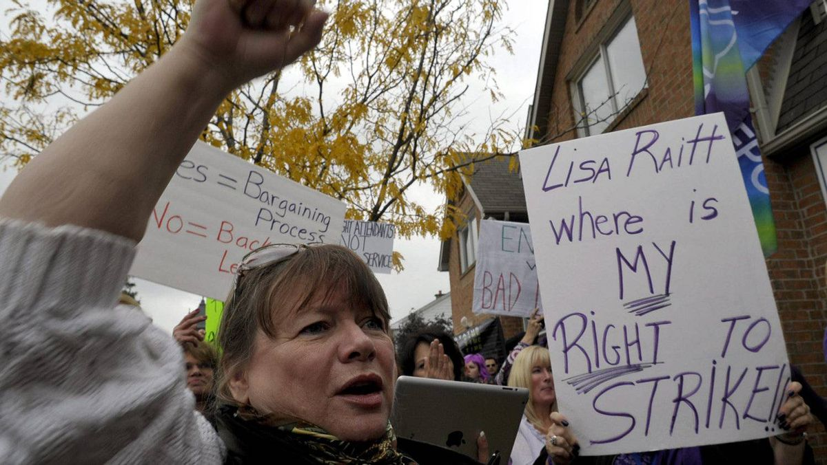 Air Canada flight attendants protested outside the federal Labour Minister's constituency office Thursday after she asked the Canada Industrial Relations Board to review stalled contract talks at the airline, effectively rendering a strike illegal.