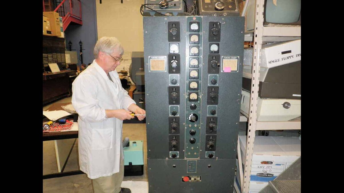 Me, disassembling a Maple Leaf 33 Radio set to look for suspect capacitors.