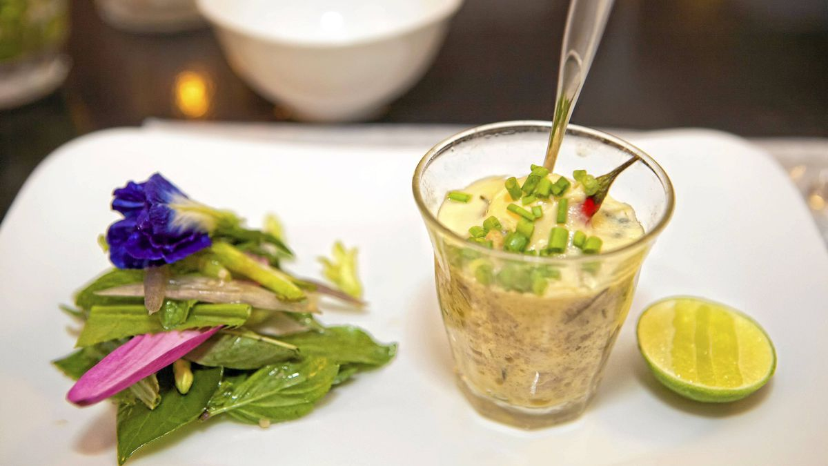 Steamed ma'am custard served with a salad of wild flowers is served in Cuisine Wat Damnak in Siem Rea, Cambodia.