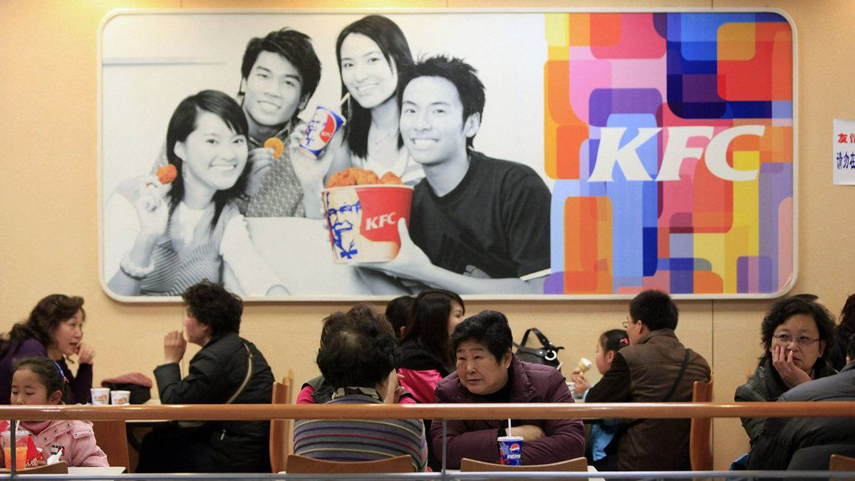 People dine at a Kentucky Fried Chicken (KFC) outlet in Shanghai in this file photo taken February 3, 2010.