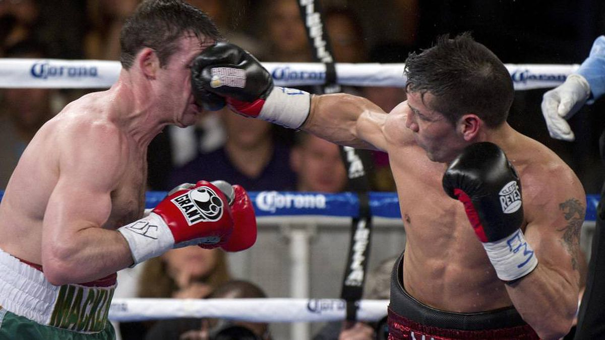 Sergio Martinez, from Argentina, lands a punch on Matthew Macklin (L), from Ireland, during their Middleweight World Championship fight at Madison Square Garden in New York.