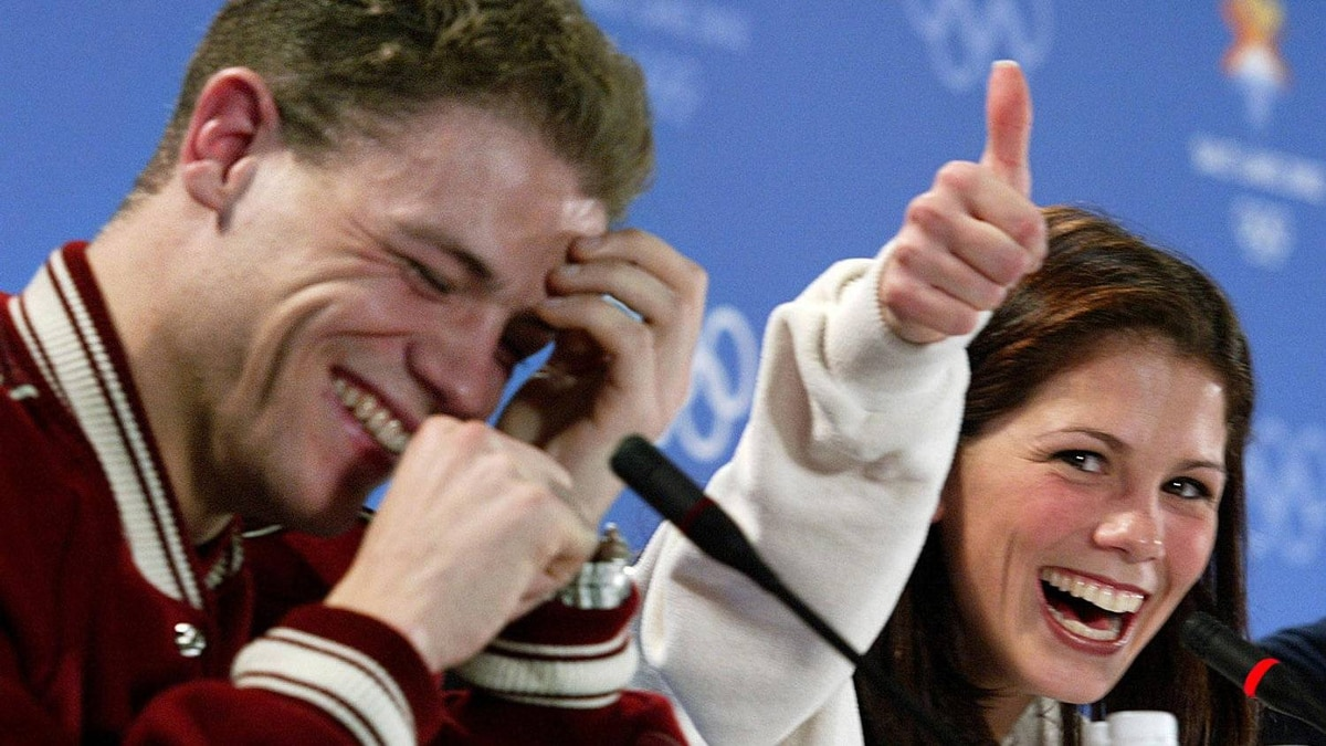 Canadian figure skating pair Jamie Salé, right, flashes a thumbs-up sign as her partner David Pelletier laughs during a press conference in Salt Lake City Friday, Feb. 15, 2002. The Canadians were awarded a gold medal after a judging controversy that dominated the Olympics and threatened the credibility of the sport. The highly unusual decision by top Olympic and skating officials also allows the Russian pair to keep their gold medal.